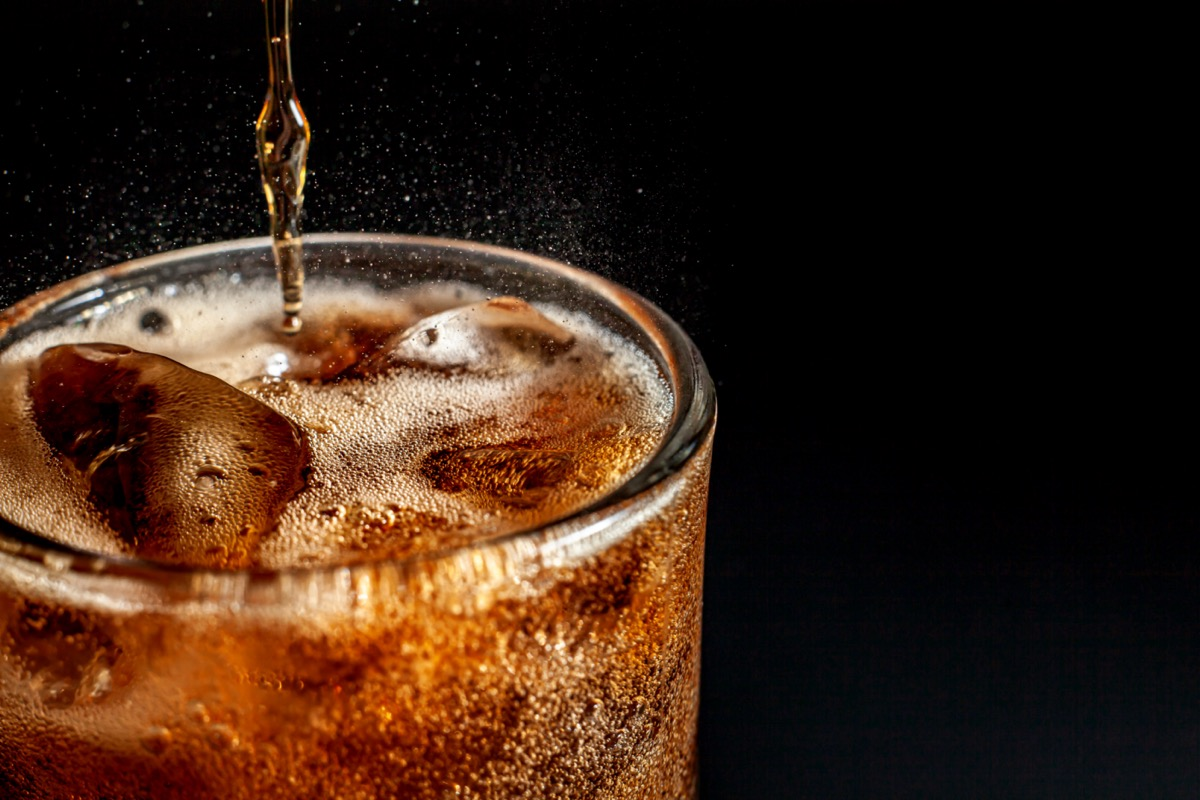 cola carbonated liquid fresh and cool iced drink in a glasses