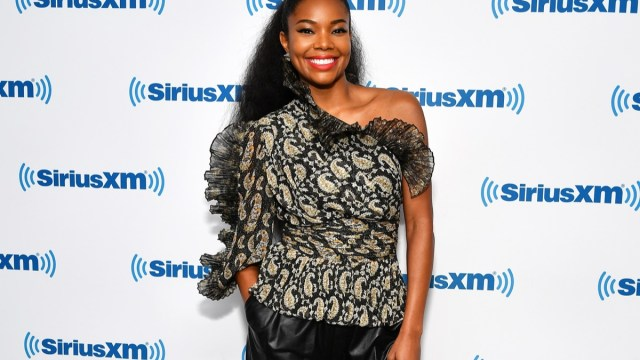 gabrielle union in black from shoulder top and red lipstick