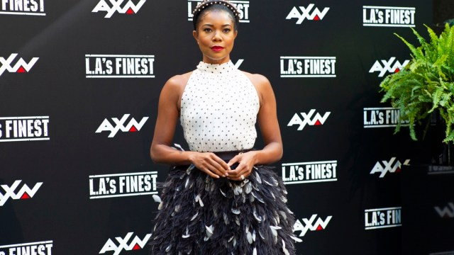 gabrielle union in white sleeves top and black skirt